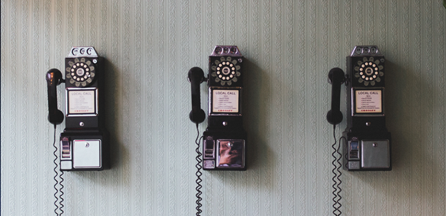 Three phones showcasing the traditional Customer support channel